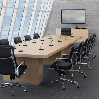 Conference room with boundary microphones on the desk